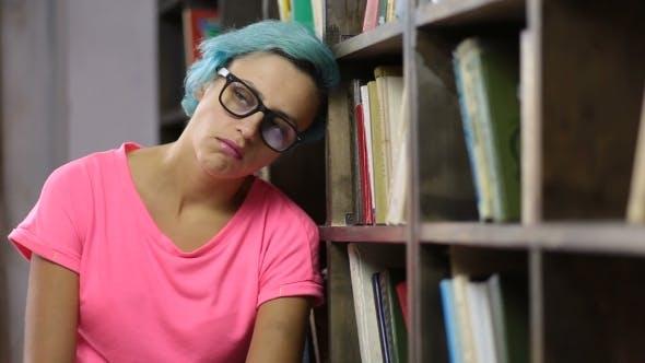 Sad Student Under Mental Pressure in Library