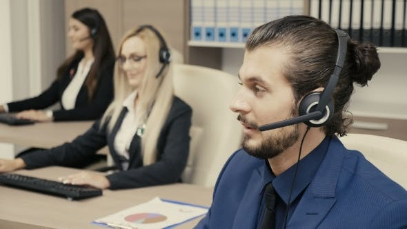 Thumbnail for Sales Marketing Team in the Office Talking on the Headphone Set