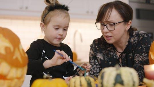 Thumbnail for Woman and Girl Decorating Pumpkins