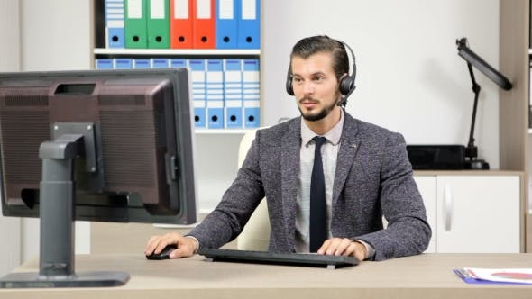 Thumbnail for Company Representative Using Headset To Talk on the Hot Line