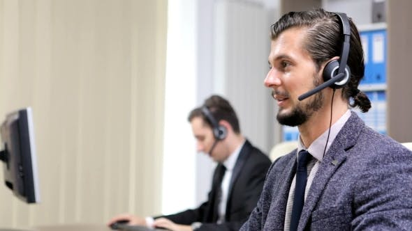 Thumbnail for Company Workers Using Headset To Talk on the Hot Line