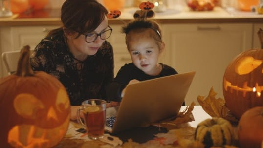 Thumbnail for Mother and Daughter Looking at Laptop Screen