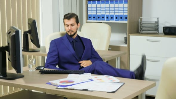 Thumbnail for Businessman Working Concentrated at His Computer