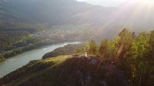 Thumbnail for A Girl in a White Dress Is Standing on a Mountain a Beautiful View From Above