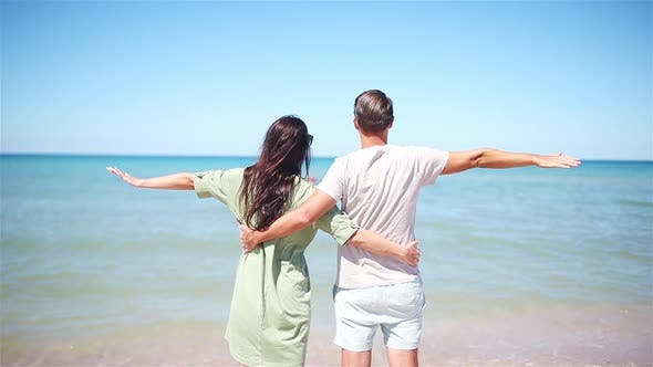 Thumbnail for Young Couple on White Beach During Summer Vacation.