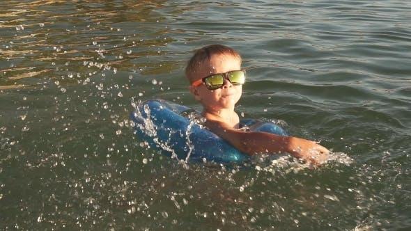 Thumbnail for Happy Little Boy Splashing in the Sea