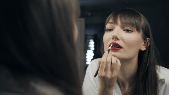 Thumbnail for Beautiful Attractive Woman Make Up Herself in Front of the Mirror Get Ready for Photoshot and Wink