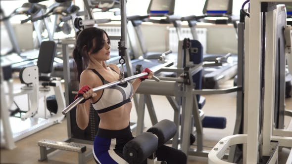 Thumbnail for Attractive Sportswoman Doing an Exercise on a Training Apparatus in the Gym