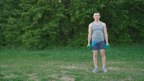 Cover Image for Guy Exercising with Dumbbells