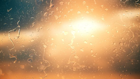 Thumbnail for The Sun in the Clouds Shines Through the Glass in the Rain Drops