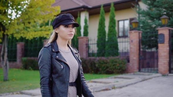 Thumbnail for Stylish Confident Model Having Walk Down Street on Urban Background