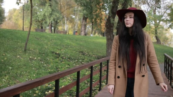 Thumbnail for Gorgeous Woman Enjoying Leisure in Autumn Park
