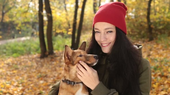 Thumbnail for Portrait of Smiling Woman with Her Dog in Autumn