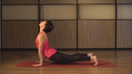 Young Woman Training Yoga - Upward Facing Dog