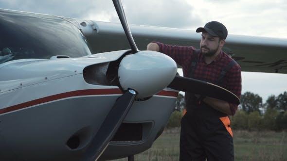 Thumbnail for Aircraft Mechanic Polishing Plane