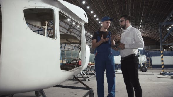 Thumbnail for Mechanic and Draftsman Near Plane Carcass