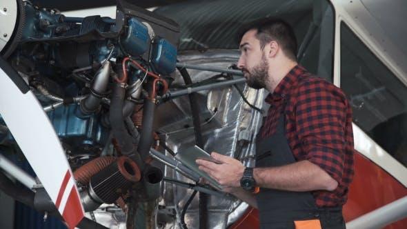 Technician Inspecting Engine