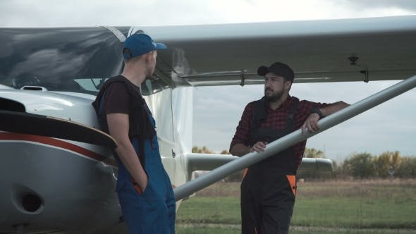 Thumbnail for Pilot and Mechanic Chatting on an Airfield