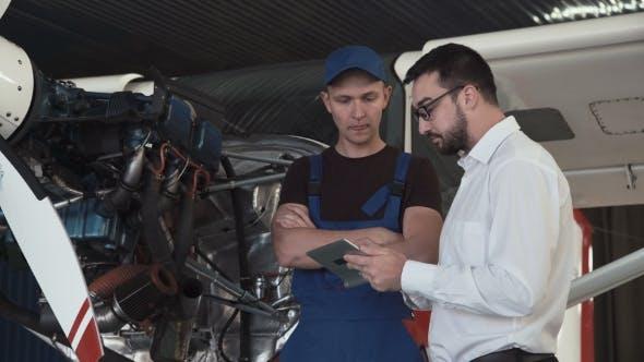 Thumbnail for Mechanic Talking To Draftsman