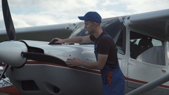 Thumbnail for Young Pilot or Mechanic Working on an Aircraft
