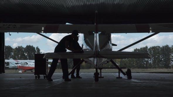 Thumbnail for Man Polishing Airplane