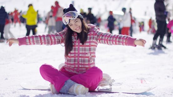 Thumbnail for Woman Sitting on Snowboard