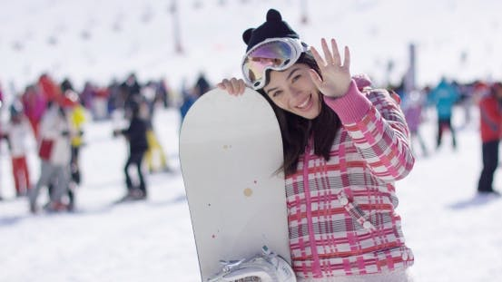 Thumbnail for Happy Woman with Snowboard