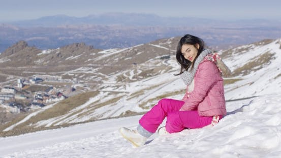 Cover Image for Smiling Woman on Snowy Slope