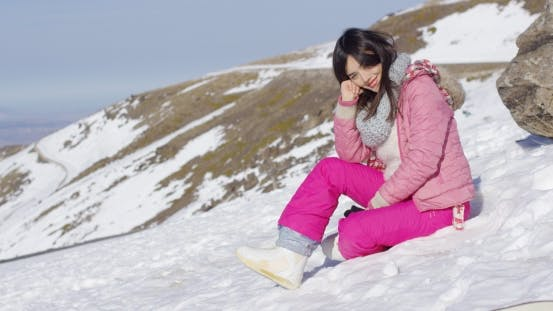 Thumbnail for Woman on Snowy Mountain Slope