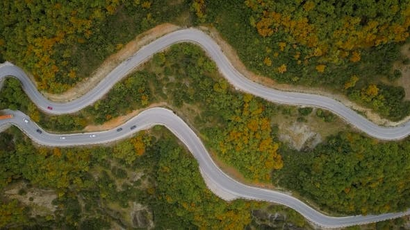 Thumbnail for Aerial View of a Traffic Driving Along a Mountain Road in Greece