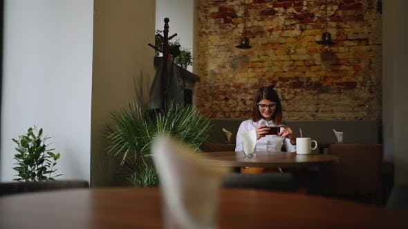 Thumbnail for Smartphone Girl Using App on Phone Drinking Coffee Smiling in Cafe Beautiful Multicultural Young