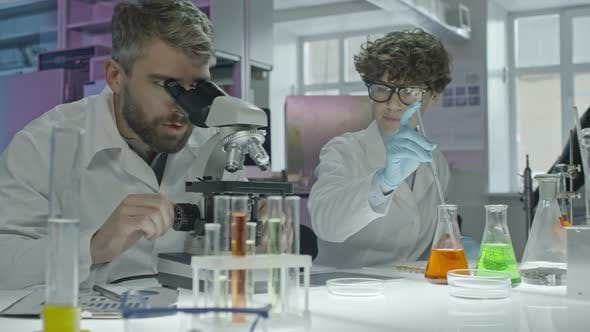 Thumbnail for Scientists Discussing Experiment in Laboratory