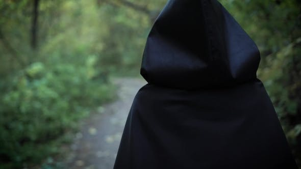 Scary Girl Is Walking in Forest