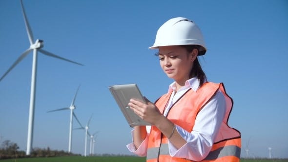 Thumbnail for Woman with Hard Hat Against Wind Turbine