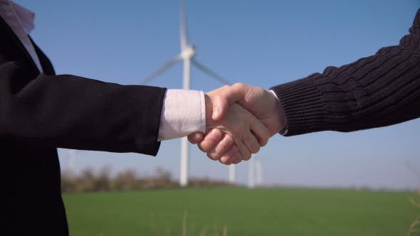 Thumbnail for Business Handshake Against Wind Turbines