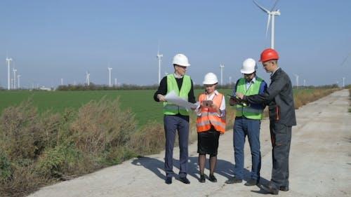 Four People Standing in Open Field