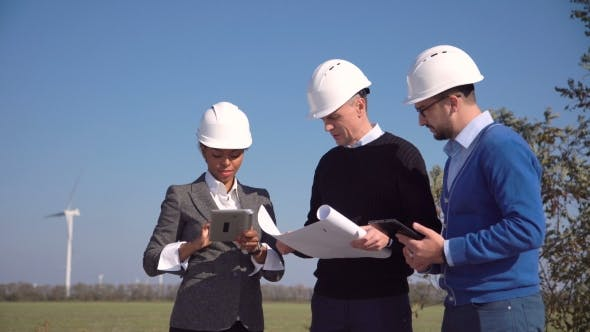 Thumbnail for Three Engineers Standing in Open Field