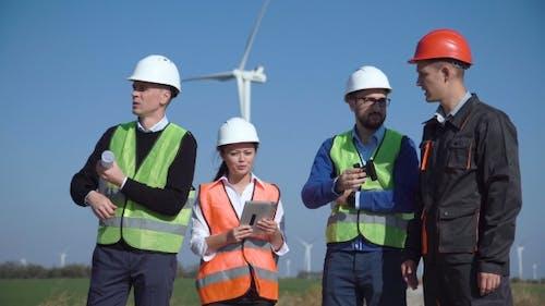 Engineers Standing in Open Field