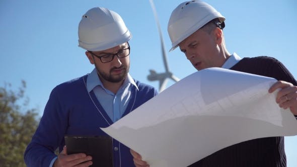 Thumbnail for Two Engineers Discussing a Blueprint