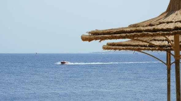 Thumbnail for Powerboat Ship Sails Along Tropical Resort Beach