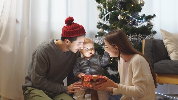 Thumbnail for Parents and Children Opening Christmas Presents at Home