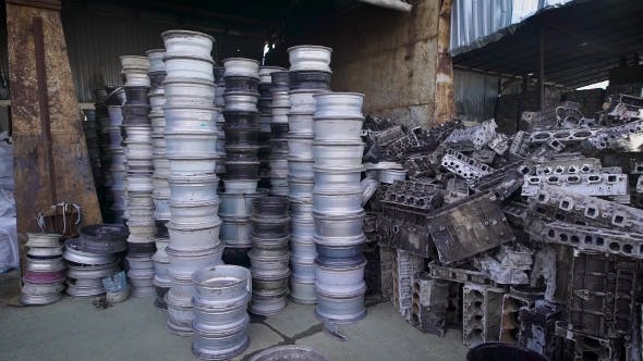 Thumbnail for A Pile of Rims and Engine Blocks Lying Together in a WarehoUSE