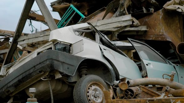 Thumbnail for Crushed Car on Salvage Yard Lying in a Pile of Scrap Metal