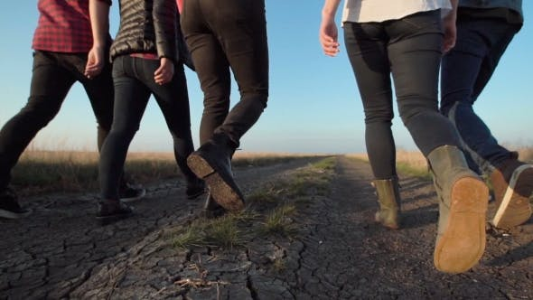 Thumbnail for Group of People Walking Along Dirt Road