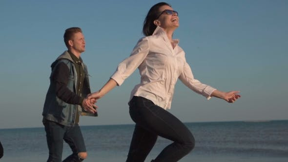 Thumbnail for Laughing Youth Running on Shoreline