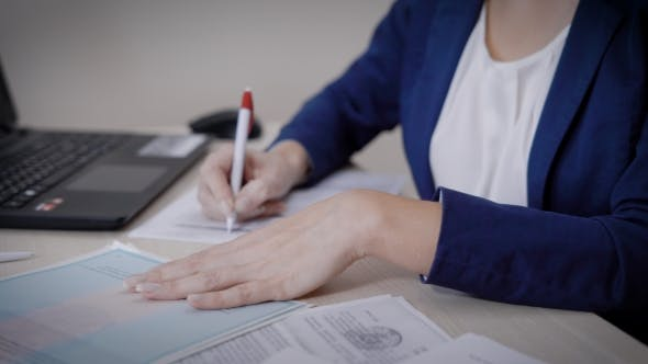 Thumbnail for Adult Woman Is Notary Is Filling Papers Using Statutory Documents Established By Law