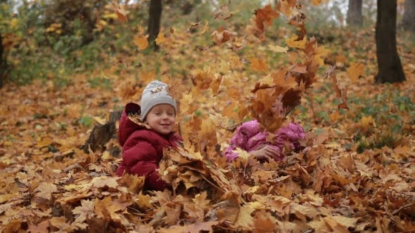 Thumbnail for Two Happy Kids Throwing Fallen Leaves Up in Fall