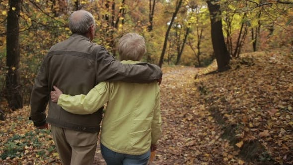 Cover Image for Elderly Couple in Love Embracing in Autumn