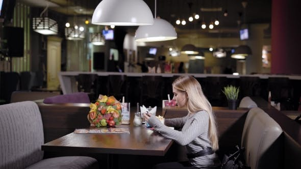Thumbnail for Beautiful Woman Is Having Dinner in a Restaurant