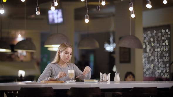 Thumbnail for Lovely Blonde Woman Drinks Coffee in a Cafe.